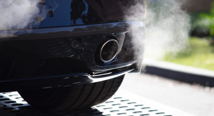 car with an idling engine - fumes produced from exhaust